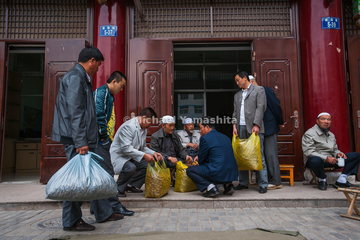 Carrying virtual fortunes in plastic bags, these traders angle for he best prices for their yartsa gombu from uighur dealers....