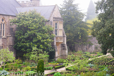 The East Garden laid out with euonymus and yew hedging at the Bishop's Palace Garden, Wells, Somerset in April