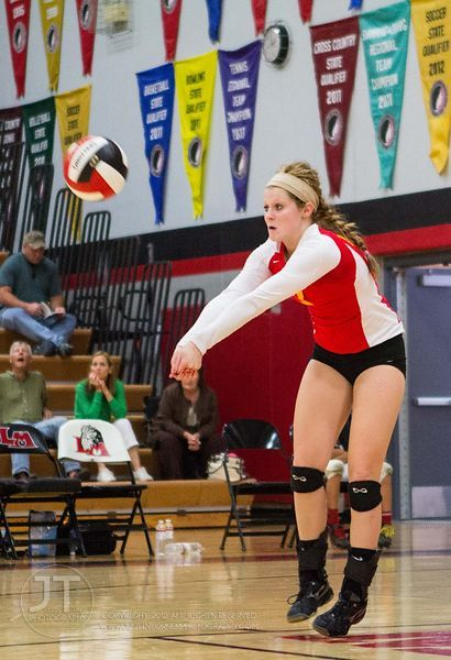 Marion's Abby Phillips (3) returns a serve at the 2012 Linn-Mar Varsity Volleyball Tourney Saturday, September 8, 2012. (Just...