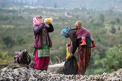 Nepalese immigrant women work at a construction site in Manali, India