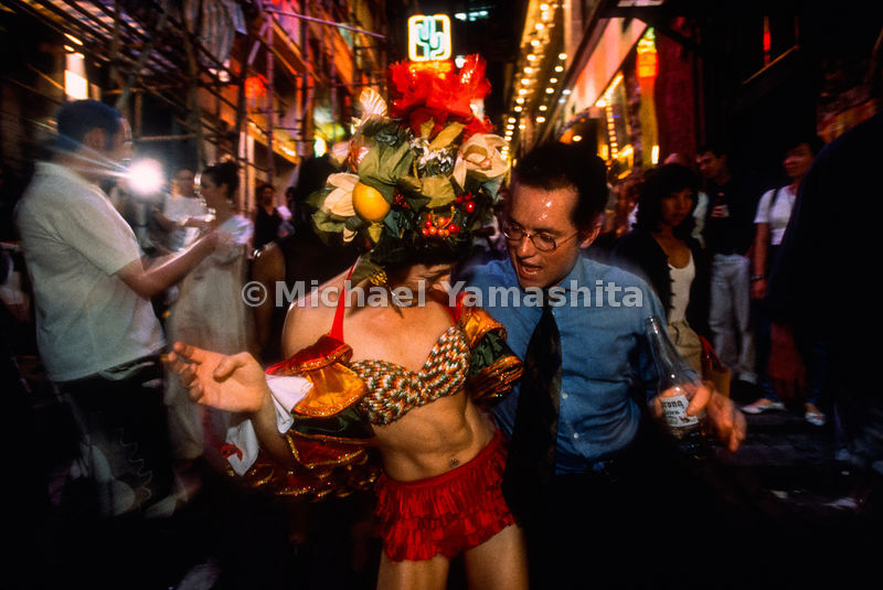 Revelers twist and shout at the Madhatters Party, an AIDS fundraising event let loose in the neighborhood of Lan Kwai Fong, h...