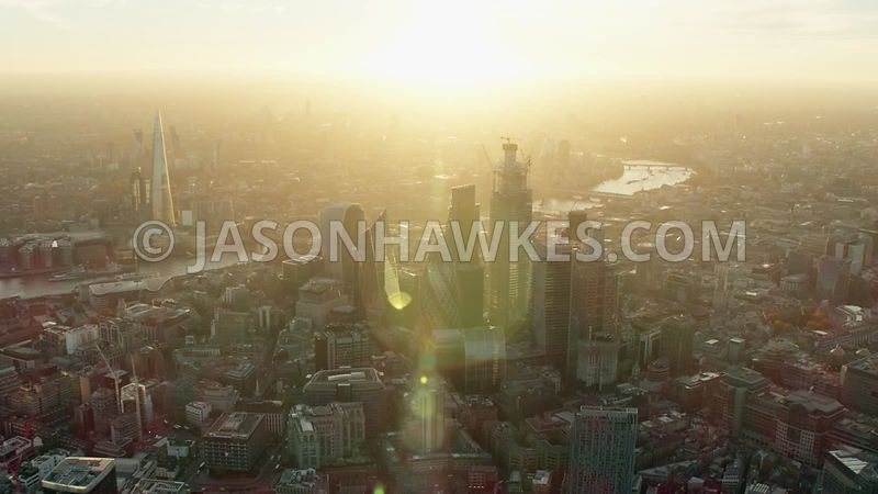 Aerial footage of the City of London, Square Mile, London at sunset.