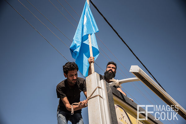 """We are putting up our flags now that the kurds have gone. We took all theirs down. Since last night we can live peacefully, ..."