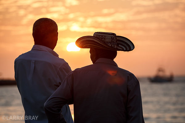 2 locals against sunset in Santa Marta, Colombia, South America