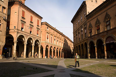 Italy - Bologna - A man walks across The Piazza di Santo Stefano