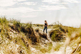 Girl in the dunes in Denmark