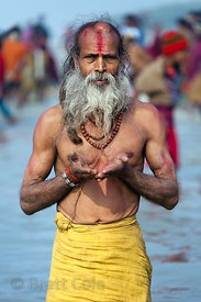 A man prays in the Bay of Bengal at the Gangasagar Mela (festival), a pilgrimage to Sagar Island in India, where the Ganges R...