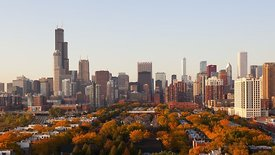 Medium Shot: South View Of A Sunset Over Chicago's Skyline In Autumn