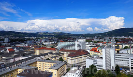 Bird view of Linz and a weather front in the horizon
