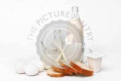 Breakfast - milk, eggs, yoghurt, toasts on white background