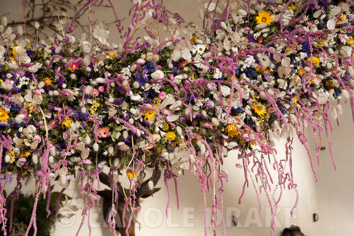 Section of the 60' long dried flower garland made from over 30,000 dried flowers and grasses inserted into a pittosporum base...