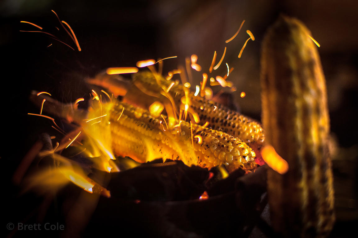 Fire-roasted corn for sale at night on Juhu Beach, Mumbai, India.