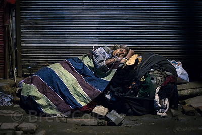 A homeless woman sleeps in the Paharganj  area of Delhi, India. A personal favorite photo. I visited the woman the next morni...