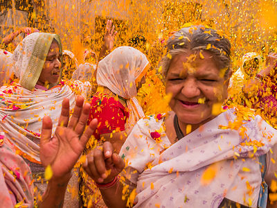 Widows chant and play holi at the Gopinath temple, Vrindavan.