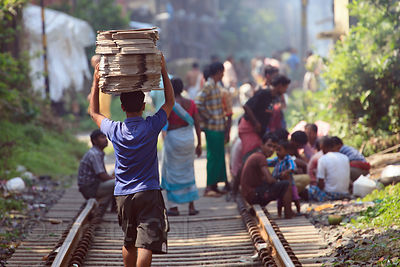 Busy scene on the railway tracks near Sovabazar Station, Kolkata, India.