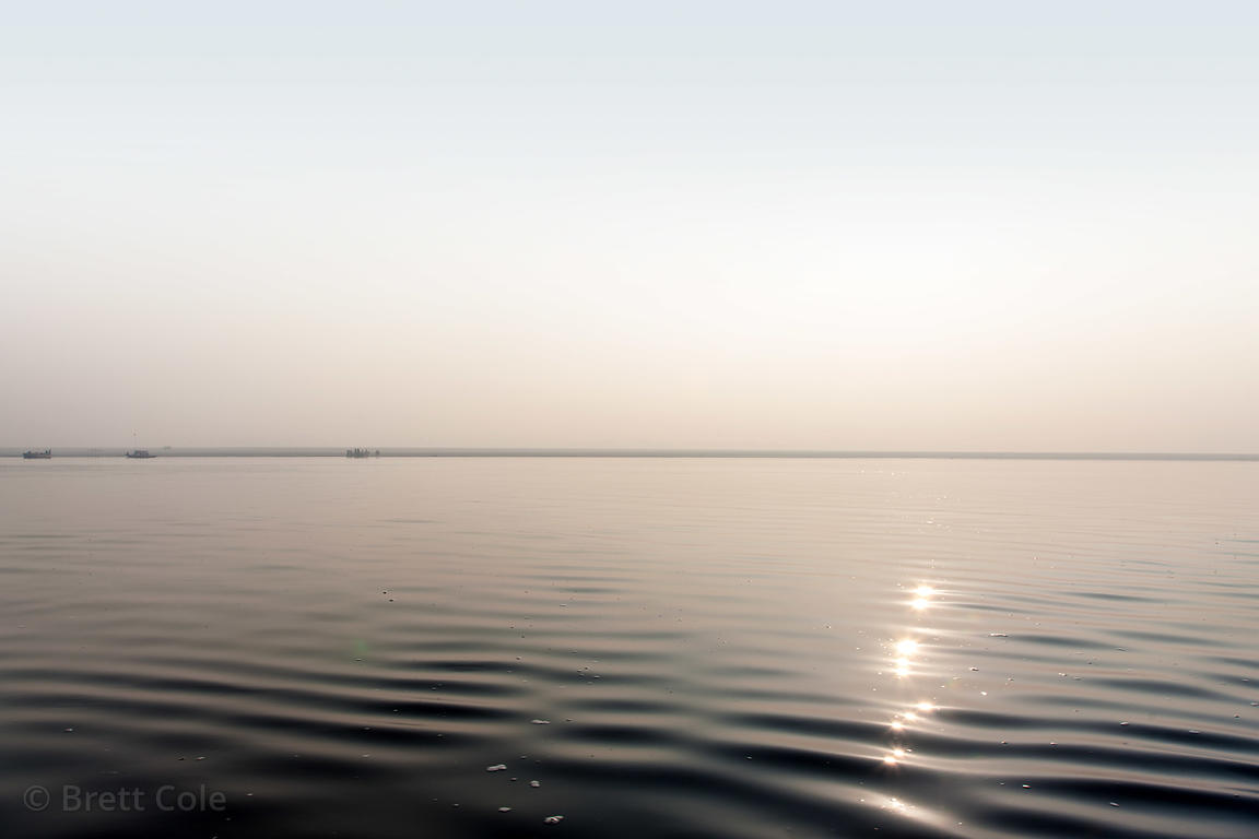 Silvery waters of the Ganges River, Varanasi, India.