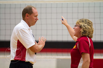 Marion coach Roxanne Paulsen argues an official's call versus Cedar Rapids Prairie at the 2012 Linn-Mar Varsity Volleyball To...