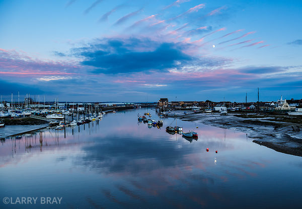 View from Adur Ferry Bridge at sunset with moon in the sky in Shoreham-by-Sea, West Sussex