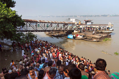 Hindus bathe en masse in the Hooghly River in observance of Mahalaya, a tribute to deceased relatives, Kolkata, India.