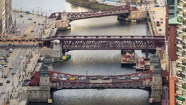 Bird's Eye: Close Up of Long Commuter Passing Over the Chicago River & Its Drawbridges