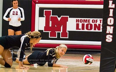Linn-Mar's Ashley Jones (8) and Brooke Roberts (13) react to missing the volley versus Dubuque Hempstead at the 2012 Linn-Mar...
