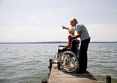 senior man and woman in wheelchair