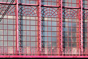 2018-10-01 Antwerp, Belgium: Glass windows and steel ornaments of the huge glass vault of Antwerp Central Railway Station.