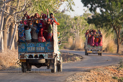 Ladies ride crowded on a truck after working at a government subsidized construcition project for the day, Picholiya village,...