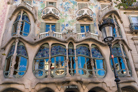 View of a some windows of Casa Batllò, an architectural masterpiece by Antoni Gaudí in Barcelona, Spain