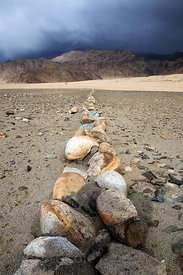 Rock line denoting a property line in the Himalayan desert near Stakna, Ladakh, India