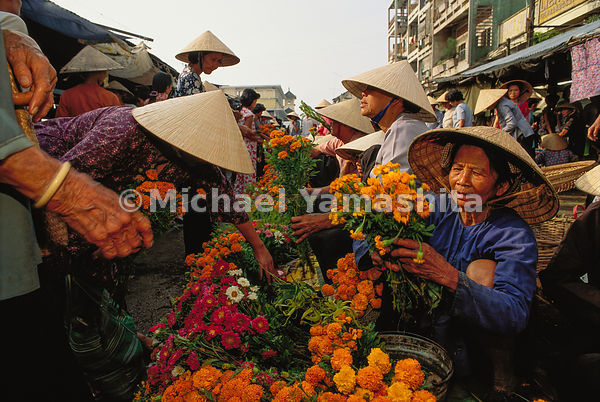Free enterprise blooms in the Vietnam delta town of Can Tho, where peddlers sell everything from snakes and blue jeans to vii...