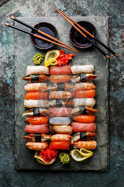 Nigiri Sushi set on gray stone slate on metal background