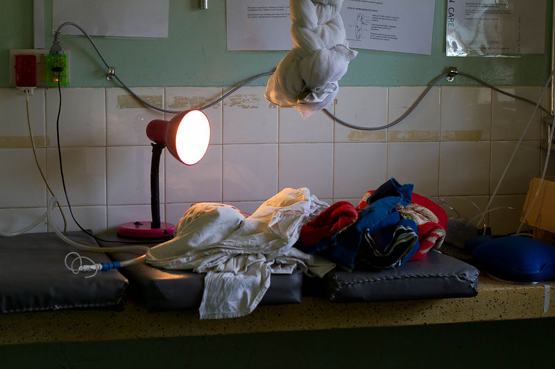 Desk lamp on premature triplets, Segerema Hospital, northern Tanzania.(for the Touch Foundation.)