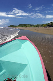 Brightly colored boats along the beach in Marino Ballena National Park, Costa Rica.