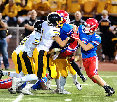 Cedar Rapids Washington's Brayden Wright (3) is picked up during a tackle by Bettendorf's Josh Licata (1)during the first hal...