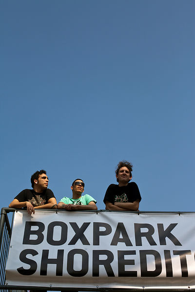 UK - London - Young men at a rooftop bar at the Boxpark - a so-called 'pop up mall' comprising of old shipping containers