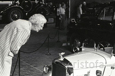 lady examines a small Bentley at the Montagu Motor Museum