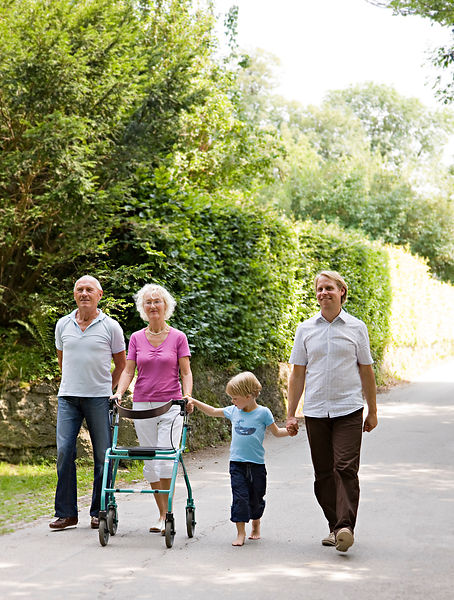 senior couple, father and son walking
