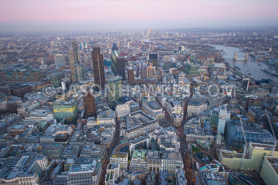 Aerial view over City of London at dusk