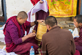 Monks cleaning prayer wheels at Gangteng Monastery, generally known as Gangtey Gonpa or Gangtey Monastery in the Wangdue Phod...