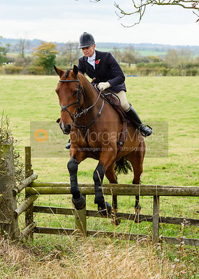 Zoe Mossman jumping onto Bruce's Lane. The Cottesmore Hunt at Somerby