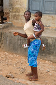 Girl carrying her sister, Elmina, Ghana