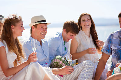 Newlywed couple laughing with friends