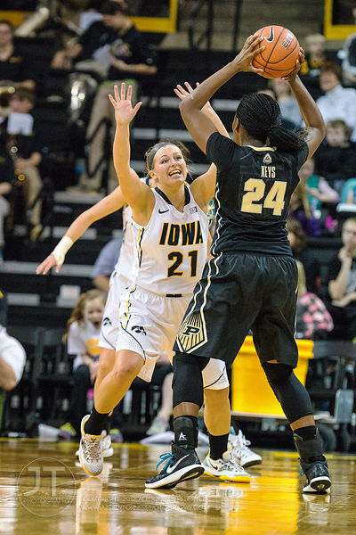 Iowa's Melissa Dixon (21) defends Purdue's Andreona Keys (24) during the second half of play at Carver-Hawkeye Arena in Iowa ...