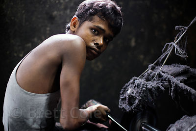 A boy works at a metal fabrication shop without any health precautions, Beniatola, Kolkata, India. Respiratory disease is a m...