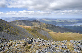 Views of the mountain ridge, The Edge, that leads upto Ullock Pike, Carl Side and Skiddaw with Bassenthwaite Lake in the dist...