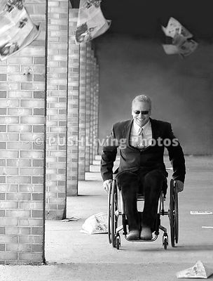 Businessman in a suit using a wheelchair