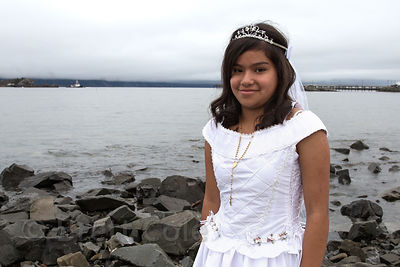 A girl has her photo taken for her prom on the beach in Crescent City, California