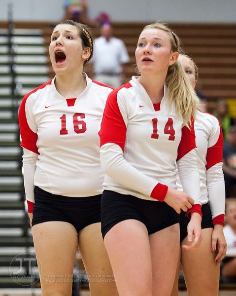 Marion players Alyssa Thomas (16) and Johanna Steggall (14) react to an official's call  at the 2012 Linn-Mar Varsity Volleyb...