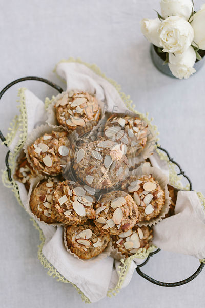 A basket full of parsnip morning glory bran muffins are photographed from the top view.